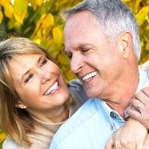 Older Couple Smiling - Dental Implants